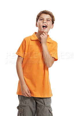 Buy stock photo Portrait of cute little kid thinking of a mischievous idea against white background