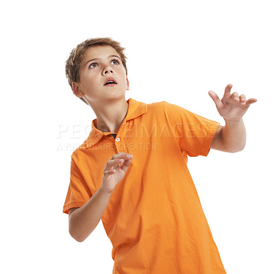 Buy stock photo Portrait of scared little boy looking up at copyspace against white background