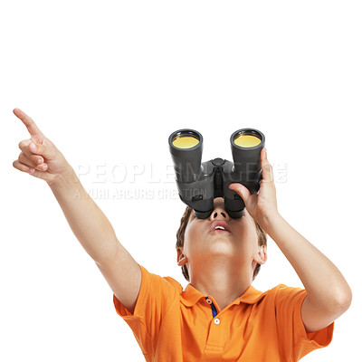 Buy stock photo Cute little boy looking through binoculars and pointing at something interesting against white background