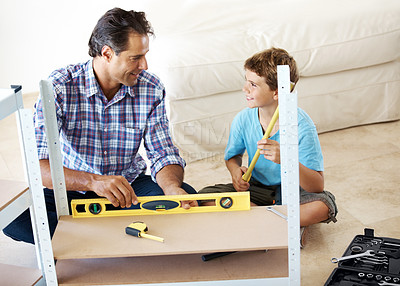 Buy stock photo Portrait of a happy man with his little son working together in carpentry workshop