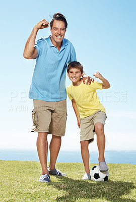 Buy stock photo Portrait of excited father and son standing outside with a football