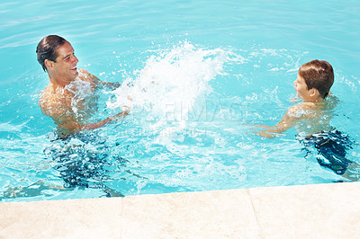 Buy stock photo 9606Portrait of a happy father and his little son playing in pool