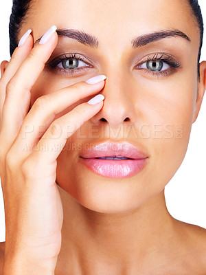 Buy stock photo Closeup portrait of a cute young woman touching her face with hands