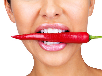 Buy stock photo Cropped image of a young lady holding red hot chilli pepper in mouth