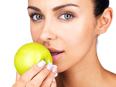 Buy stock photo Closeup portrait of a cute young female eating a green apple against white background
