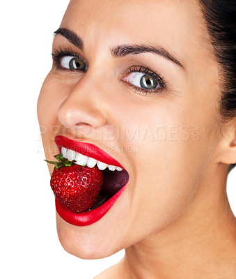 Buy stock photo Closeup portrait of a beautiful young woman with strawberry in her mouth