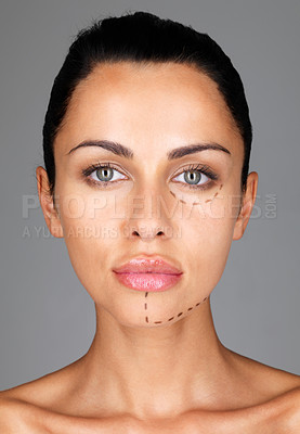 Buy stock photo Drawn lines on a brunette woman's face as marks for facial plastic surgery