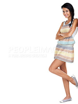 Buy stock photo Full length of a happy young lady standing with her hands folded against white background