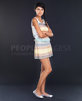 Buy stock photo Beautiful young woman standing with folded hands over grunge background - Copyspace