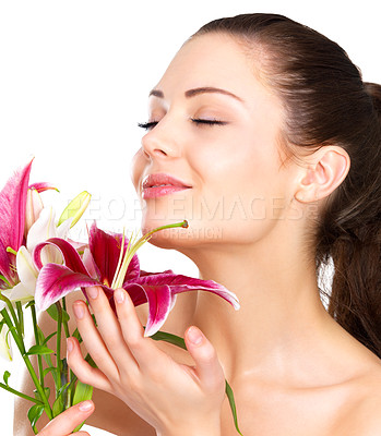 Buy stock photo Beautiful portrait of a young sexy woman smelling the flowers.