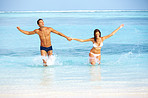 Couple having carefree moments on beach