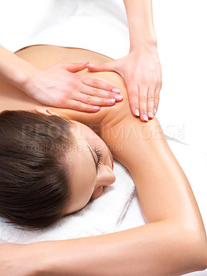 Buy stock photo Massage therapy and hands massaging - Portrait of a pretty young woman getting a massage at the day spa
