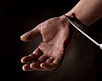 Young man cutting veins attempting suicide