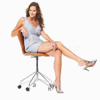 Buy stock photo Full length of smiling woman sitting on chair and playing with her heels against white background