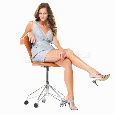 Buy stock photo Full length of pretty woman sitting on chair and playing with her heels against white background