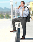 Business man talking on phone outside in the sun