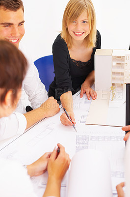 Buy stock photo Cropped shot of a group of coworkers discussing work in the boardroom