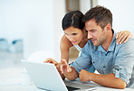 Couple pointing at laptop