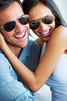Couple in sunglasses spending happy time together