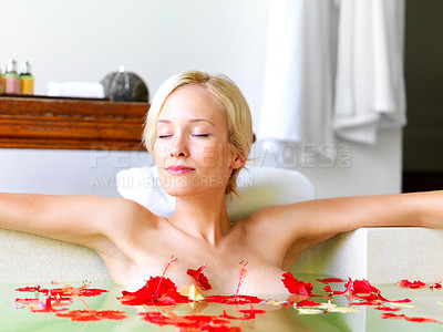 Buy stock photo Gorgeous young woman relaxing in the bath tub with flowers