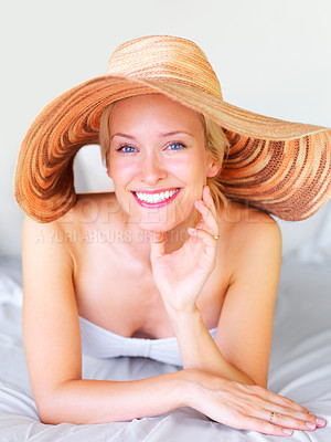 Buy stock photo Portrait of smiling young woman in lingerie lying on a bed