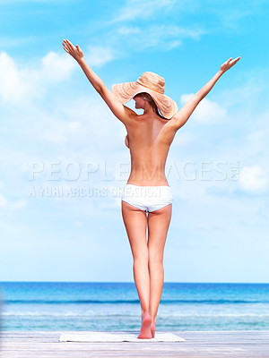 Buy stock photo Topless young woman on the beach with raised arms enjoying the sun