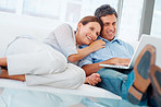 Cute elderly couple at home using a conputer
