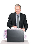 Senior male entrepreneur with a briefcase of money