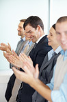 Business team clapping a good presentation in office