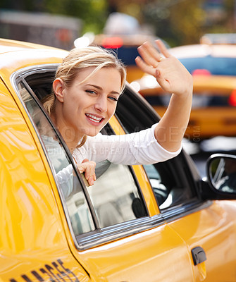 Buy stock photo Portrait of a beautiful woman waving at you from the window of a yellow taxi cab