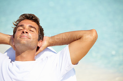 Buy stock photo Top view of young man relaxing on chair with eyes closed