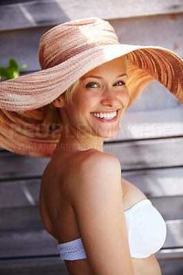 Buy stock photo Portrait of a beautiful young woman smiling while outdoors wearing a classic beach hat