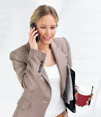 Buy stock photo Portrait of young beautiful smiling business woman talking on her cell phone and drinking coffee