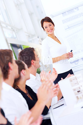 Buy stock photo Cropped shot of a group of coworkers applauding their colleague's presentation