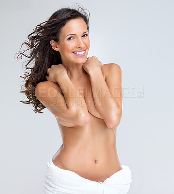 Buy stock photo Portrait of pretty young woman smiling while covering her breasts
