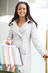 Portrait of young joyful lady with her shopping bags