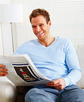 Modern life - young man laughing and reading  newspaper