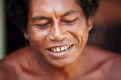 Buy stock photo Closeup of an indigenous Thai man smiling thoughtfully