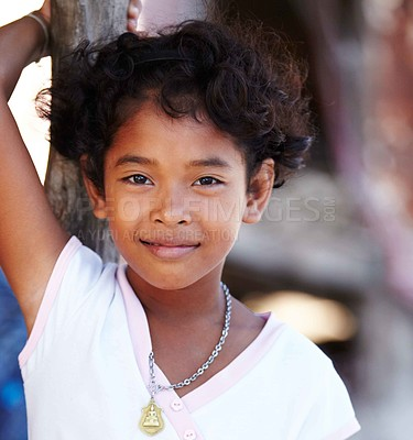 Buy stock photo Close-up of a young girl from a village in Thailand smiling