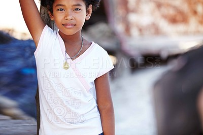 Buy stock photo Portrait of a young rural girl from Thailand standing and looking