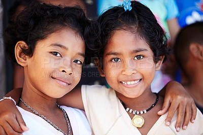 Buy stock photo Close-up Portrait of two little girls from rural Thailand holding each other.