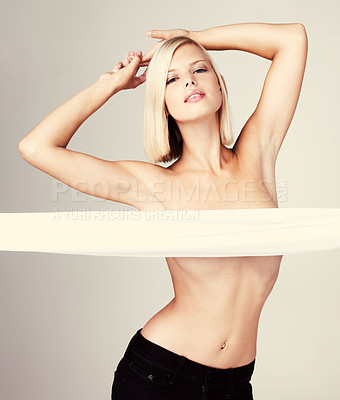 Buy stock photo Attractive young woman posing topless isolated on grey