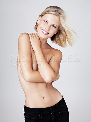 Buy stock photo Gorgeous young woman posing with her arms across her chest isolated on grey