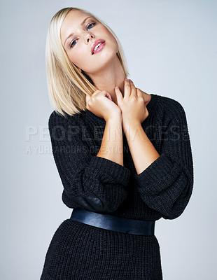 Buy stock photo Pretty young woman posing isolated on grey