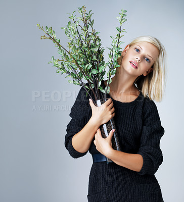 Buy stock photo Pretty young woman isolated on grey while holding a plant