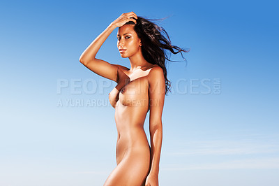 Buy stock photo Beautiful nude woman standing outside looking at camrea with her hand in her hair
