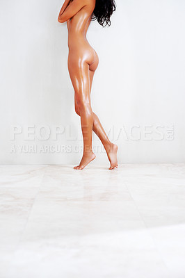 Buy stock photo Cropped shot of a nude young woman indoors
