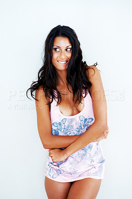 Buy stock photo An attractive young woman looking mischievous about to remove her top