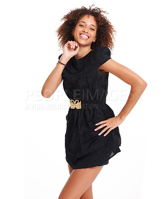 Buy stock photo Flirty young woman posing happily while isolated over a white background