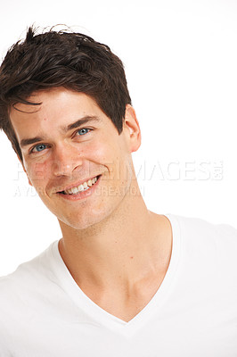 Buy stock photo Relaxed young man smiling while isolated on white - head and shoulders portrait